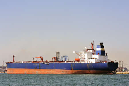 quay tanker to discharge its cargo in France with the wearing of Fos-sur-Mer beside Marseille Stock Photo