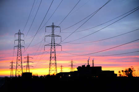 Line with high voltage with the last gleams of the day  photo