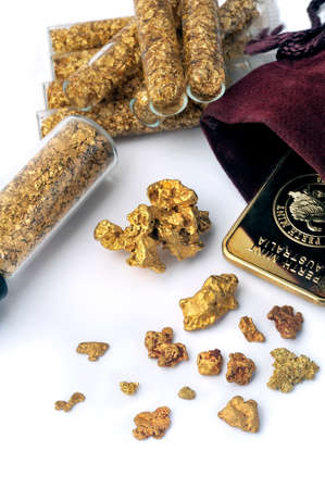 nuggets and gold bullion in studio on white background photo