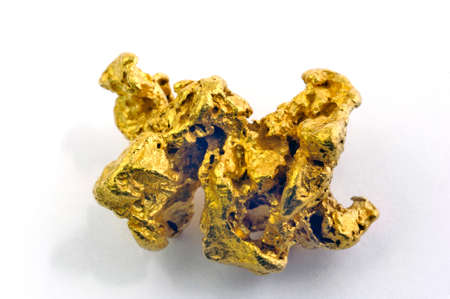 gold nugget in the studio very close photo