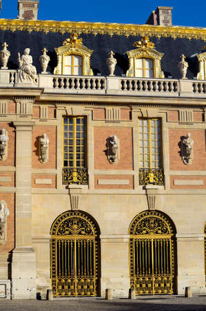 gilding: chateau de Versailles, architectural detail and gilding of the facade and roof Editorial