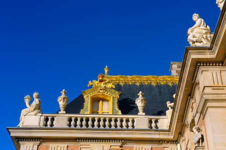 gilding: Castle of Versailles, architectural detail and gilding of the facade and roof Editorial