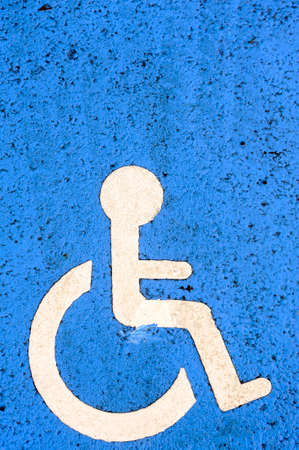 Parking space for disabled before a new building photo