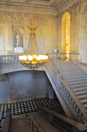 A monumental staircase of the palace of Versailles