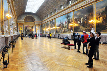 tourists visiting the castle of Versailles