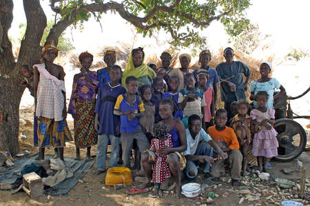 group of African villagers posing for the camera in their village