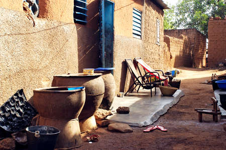 burkina faso: an old lane Bobo-Dioulasso where a small terrace was arranged for the comfort of its inhabitants