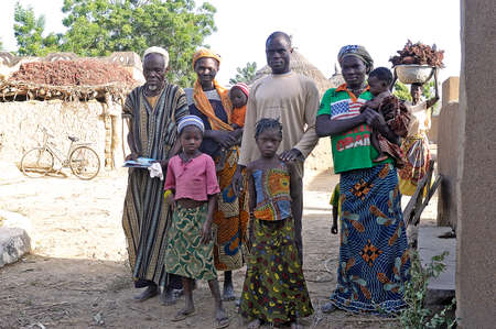 portrait of a group of villagers in a village in Burkina Faso
