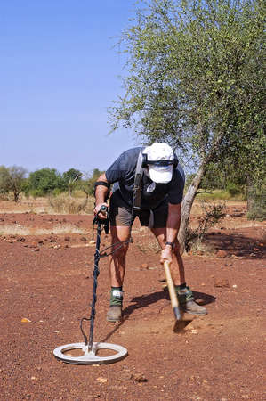 a French gold prospector working in the African savannah in Burkina Faso
