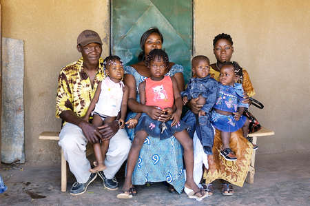 portrait of an African family outside his home in Ouagadougou Editorial