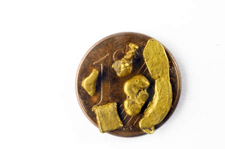 alluvial: small alluvial gold nuggets found in France and placed on a one euro coin cent