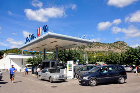 Service station on a French supermarket car park where the prices are generally lower than in a normal station.