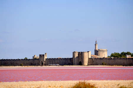 The ramparts of the walled city of Aigues-Mortes seen pink salt
