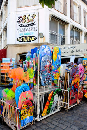 beachwear shop in the town of Saintes-Maries-de-la-Mer center during the summer season.