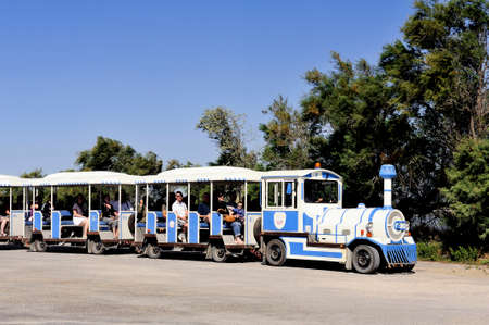 mine site: tourists in the tourist train to visit the salt business of Aigues-Mortes and to turn the salt mine site.