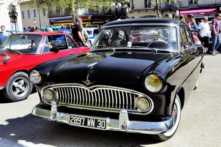 Simca Chambord black manufactured between 1958 and 1961 photographed vintage car rally in the square of the Town Hall of the city of Ales