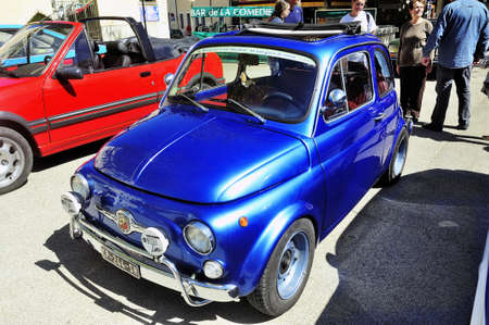 Old Fiat 500 Abarth racing equipped photographed vintage car rally Town Hall Square in the town of Ales Editöryel