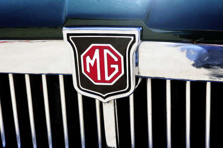 Detail of the MG brand on an old car radiator photographed vintage car rally Town Hall Square in the town of Ales, in the Gard department