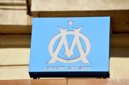 olympic symbol: Light box with the logo of the OM football club, Olympic Marseille on the front of the club brasserie in the old port Editorial