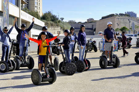 segway: Tourist group moving Segway to visit Marseille here on the old port Editorial