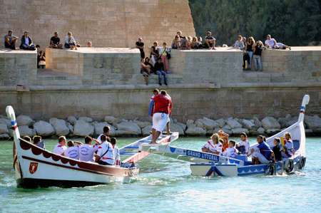 nationalities: Jousting on the old port of Marseille to the delight of tourists of all nationalities.