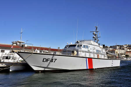 border patrol: French customs boat docked in the Old Port of Marseille
