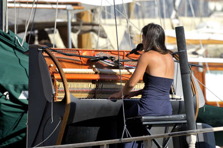 gave: Singer gave a concert on an old sailboat docked in the Old Port of Marseille
