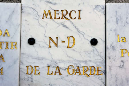 votive: votive offerings or thanksgiving to Our Lady of the Guard of Marseille materialized by a marble plaque for a wish come true Editorial