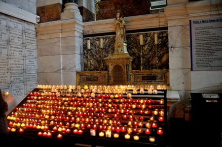 realization: Offerings in the form of candles to the Good Mother and Notre Dame de la Garde in Marseille to ask for the realization of a wish Editorial