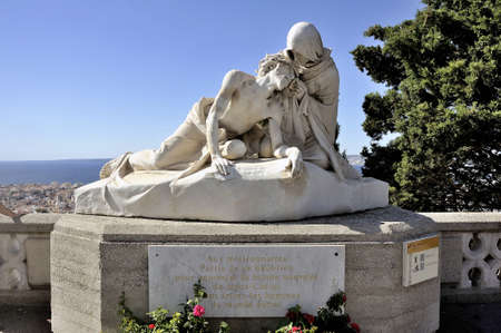 homage: Statue in front of the Basilica of Notre Dame de la Garde in Marseille in homage to the missionaries left this place around the world
