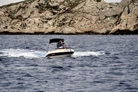 pine creek: A man at full speed on a small boat in the national park creeks between Marseille and Cassis