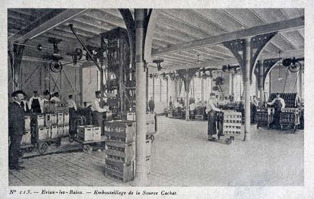 bottling: old postcard, evian, bottling Editorial