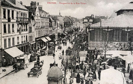 old postcard: old postcard of Troyes, perspective of the street thiers