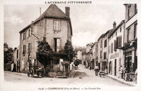 old postcard: old postcard of Combronde, high street Editorial