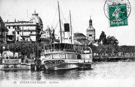 old postcard: old postcard of Evian, harbor Editorial