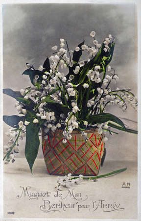 good luck charm: old postcard of a lily bouquet of a good luck charm That awaits the May 1
