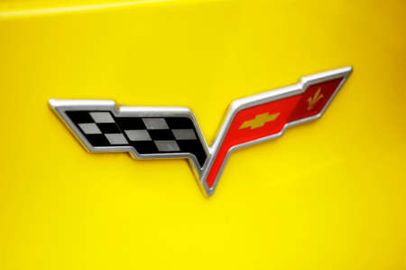corvette: A yellow corvette exposed to a gathering of American motorcycles in Beaucaire in the French department of Gard