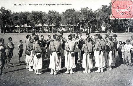 algerian: Algerian old postcard from 1910 - Blida - Music of the First Regiment of Riflemen Editorial