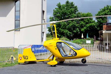 aerodrome: Gyroplane parked at the foot of the control tower of the aerodrome