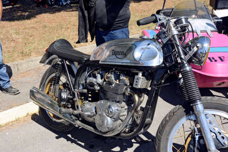 sought: an old motorcycle triumph triton is a rare and sought after model made at the time by Triomph and Norton