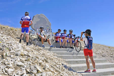 mount tom: Commemorative stela of Tom Simpson died on the Tour de France to Mont Ventoux, cyclists stop in homage to the great cycling champion Editorial