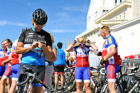 climbed: Numerous cyclists who climbed Mount Ventoux bike celebrate their performance atop proud of them and happy to be arrived Editorial