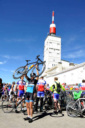 Numerous cyclists who climbed Mount Ventoux bike celebrate their performance atop proud of them and happy to be arrived Editorial
