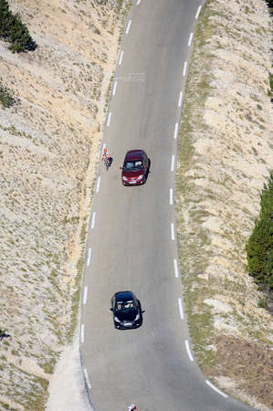 borrowed: Road Mont Ventoux amount borrowed by many cyclists and cars Stock Photo