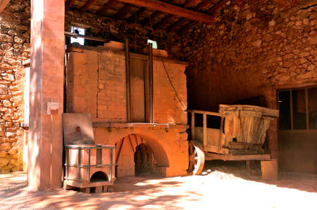oven of Roussillon ocher factory where was treated ore to produce products such as dye for painting or various other applications. Stock Photo