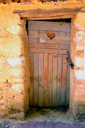 roussillon: an old door in Roussillon ocher factory where was treated ore to produce products such as dye for painting or various other applications.