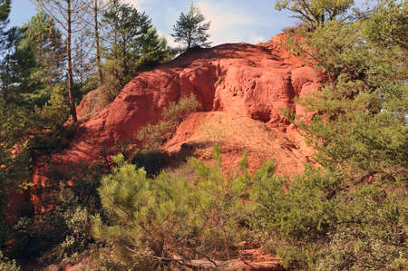 red landscape dug by six generations of miners ocher Colorado Provencal at Rustrel in the south of France