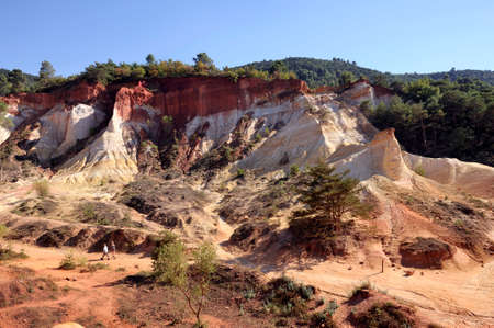 yellow  ochre: red landscape dug by six generations of miners ocher Colorado Provencal at Rustrel in the south of France