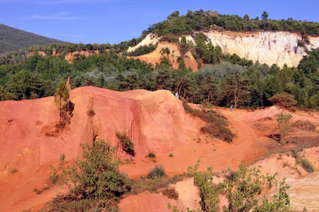 the miners: red landscape dug by six generations of miners ocher Colorado Provencal at Rustrel in the south of France