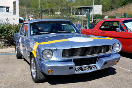 American car gathering at the mechanical pole of the town of Ales in the French department of Gard, here a ford Mustang blue